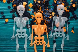 Halloween party decorations skeleton on dark green