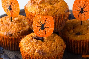 Pumpkin muffins for Halloween kids party on white