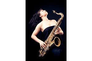 Young Woman Playing The Sax