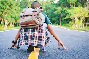 Asian boy backpack in the road