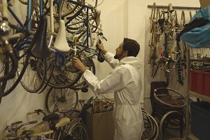 Worker working at bicycle workshop