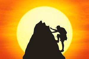 Silhouette of boy climbing
