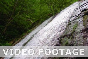 Mountain river waterfall in slow motion
