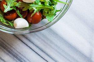 Fresh salad on marble table