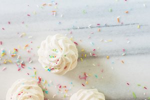 French meringues on marble table