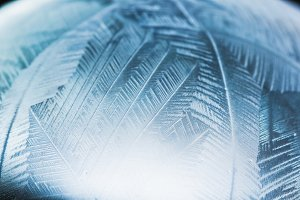 Frozen snow pattern close-up, winter holidays background,