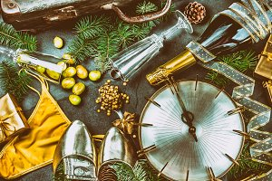 LATIN AMERICAN AND SPANISH NEW YEAR TRADITIONS. empty suitcase, lentil spoon, yellow interior clothes, gold ring in champagne, 12 grapes, money in shoe. Christmas background