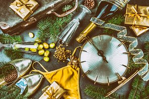 LATIN AMERICAN AND SPANISH NEW YEAR TRADITIONS. empty suitcase, lentil spoon, yellow interior clothes, gold ring in champagne, 12 grapes, money in shoe - CHILEAN MONEY. Christmas background