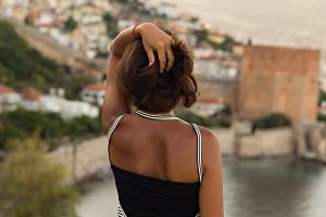 Backview portrait of fit woman enjoying the view of the bay of A