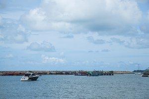 Boat moored ships at sea.