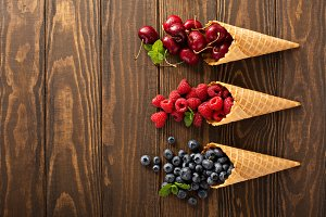 Fresh fruit and berries in waffle cones