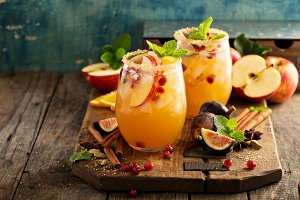 Fall sangria cocktail with apple, figs and orange