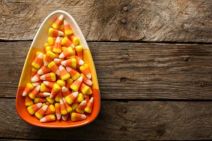 Candy corn in a bowl Halloween background