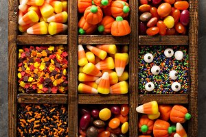 Halloween candy and sprinkles in wooden box