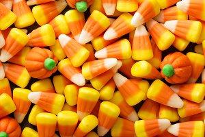 Candy corn and pumpkin Halloween background