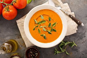 Tomato soup with olive oil and herbs