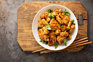 Spicy sweet and sour chicken with rice and cabbage