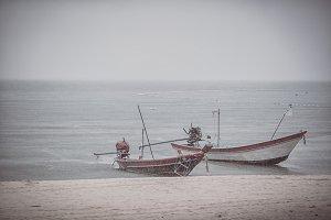 Two fishing boats in the rainy season Thailand