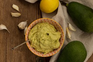 Avocado sauce in small bowl with etnic pattern