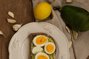 Toast with boiled egg and avocado sauce