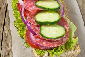 Sandwich with salami, tomato and let