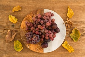 Grapes and plums on vintage plate