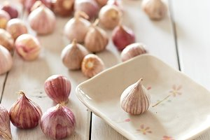 Fresh healthy garlic on white table