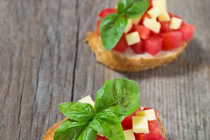 Italian bruschetta with tomato, chee