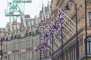 A lot of british union jack flag on the street of london