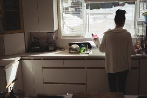 Woman standing near the kitchen sink