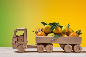 Toy wooden truck with tangerines.