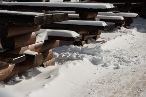 Wooden equipments covered with snow