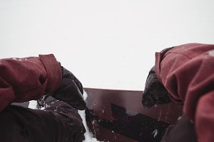 Skier relaxing on snowy slope in ski resort