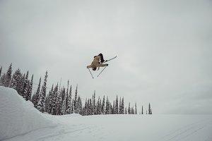 Man skiing on snowy alps in ski resort