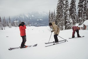 Group of people skiing on snowy alps in ski resort