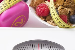 scale with tape measure, cufflinks, concept of diet and health food