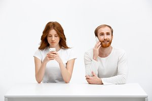 Tenderless redhead girl and boy talking on phones  chatting a