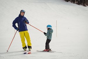 Father and daughter having fun while skiing