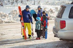 Family preparing for ski
