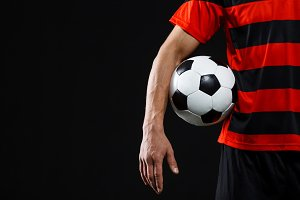 Close up of athlete with soccer ball