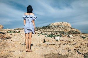 woman standing on rocky desert