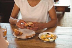 Lesbian couple having breakfast