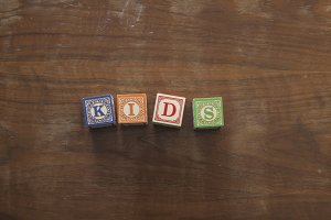Kids in wooden blocks