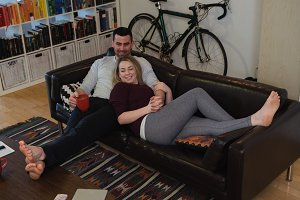 Couple relaxing on sofa in living room