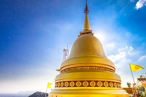 Big golden Stupa of a Buddhist temple. Thailand