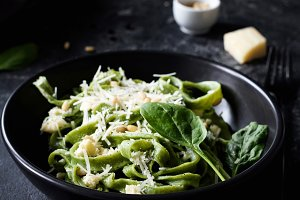 Green spinach pasta with cheese and pine nuts