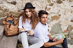 Two young tourists enjoying the day in the old town.