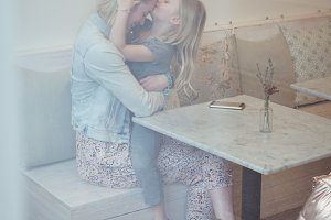 Daughter kissing mother on forehead