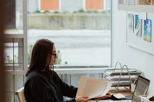 Female executive working at desk