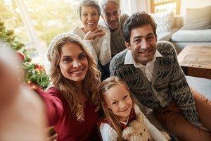 Happy extended family taking selfie